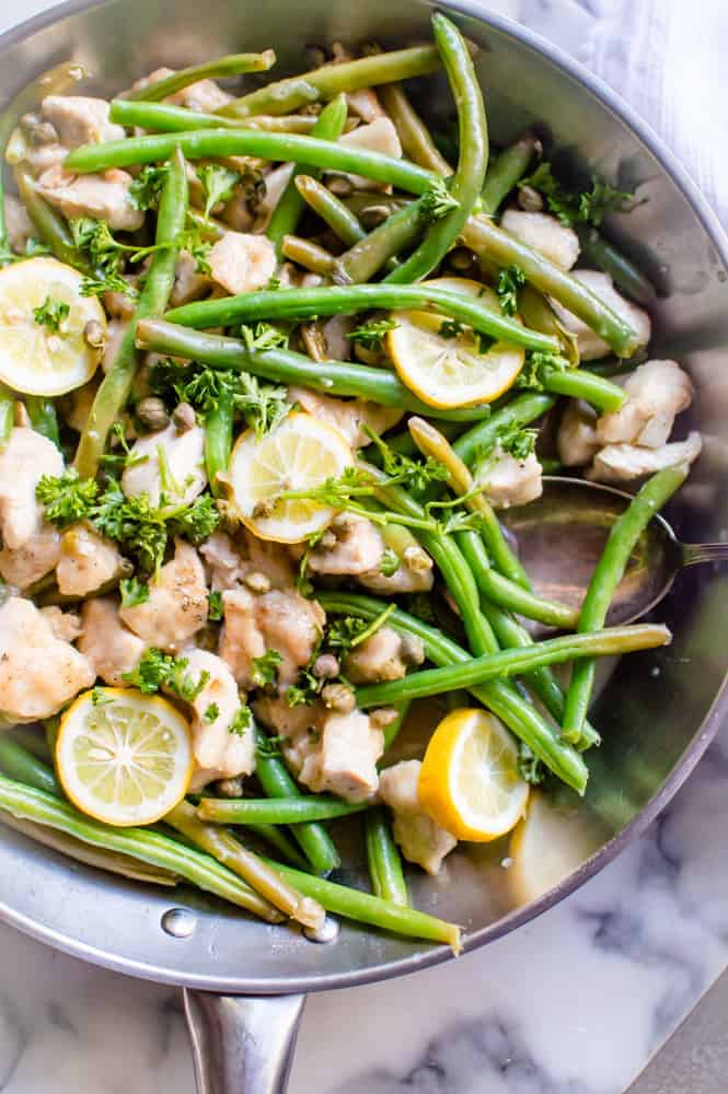 Chicken Piccata Stir-Fry in the skillet on a marble table.