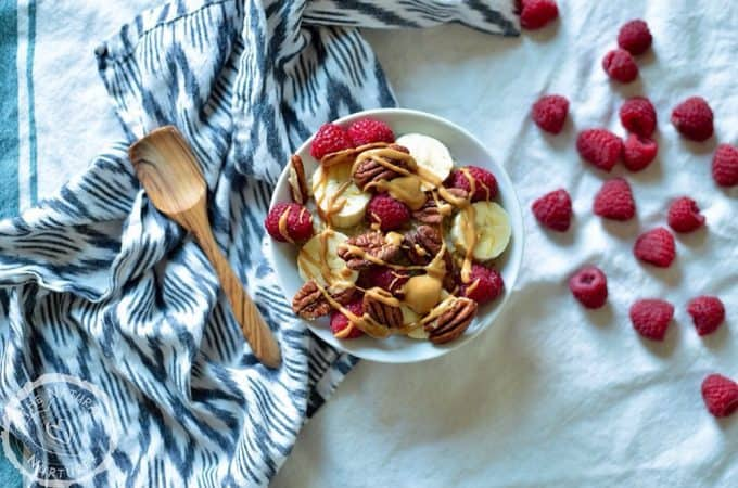 Overhead on the Perfect Bowl of Steel Cut Oats with raspberries around the bowl