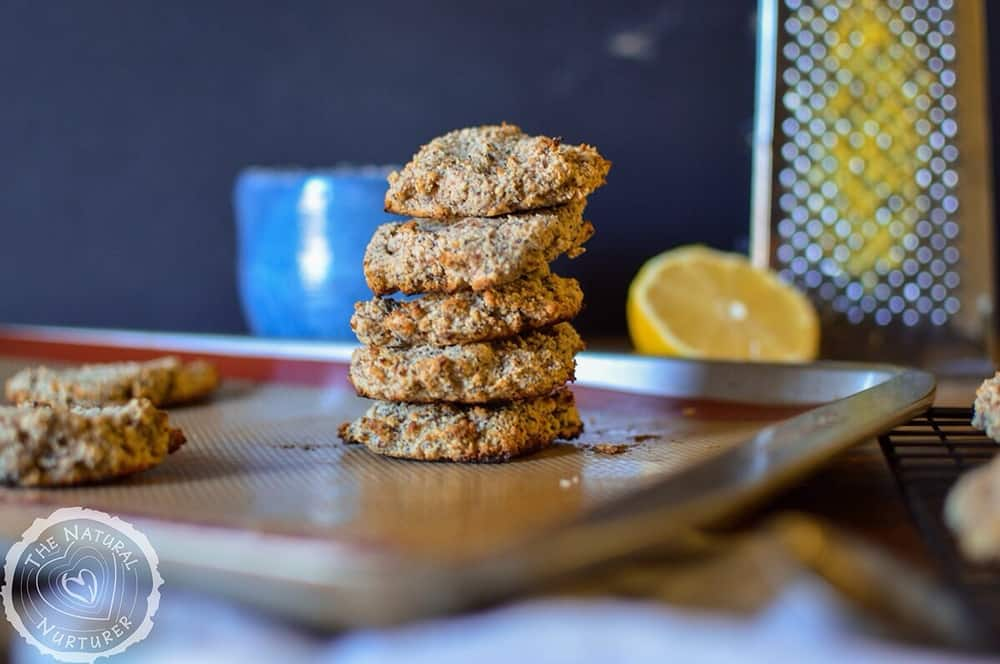 A big stack made of 5 Paleo Lemon Breakfast Cookies with more of them in the background.