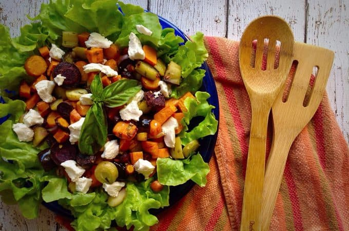 Overhead on the Roasted Vegetable Salad with Goat Cheese served in a blue plate