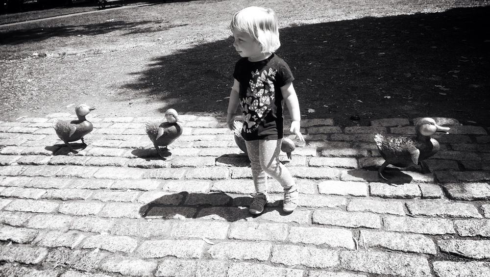 Making friends with the duck statues for Make Way For Duckling