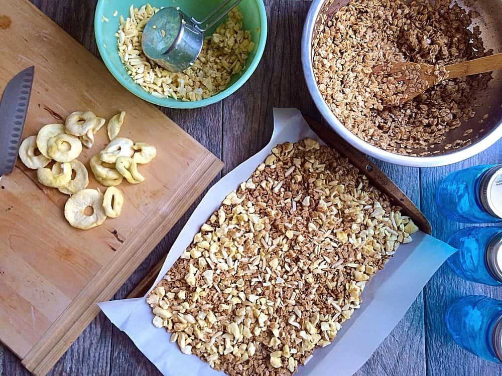 Cinnamon Apple Almond Granola being prepped on a table.