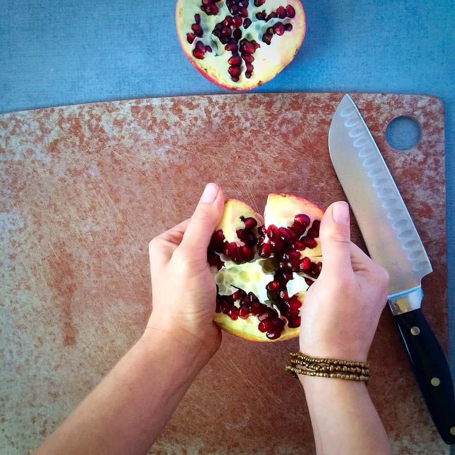 Breaking the pomegranate into pieces