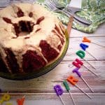 Closeup of the Applesauce Date Cake with the colorful Birthday letters next to the cake