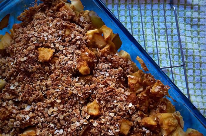 Closeup of the Simple Apple Crisp ready and baked in a glass tray and presented on a rack