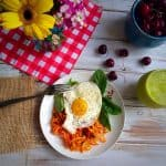 Stove Top Sweet Potato Spirals served with an egg and spinach together with smoothie and cherries on the side