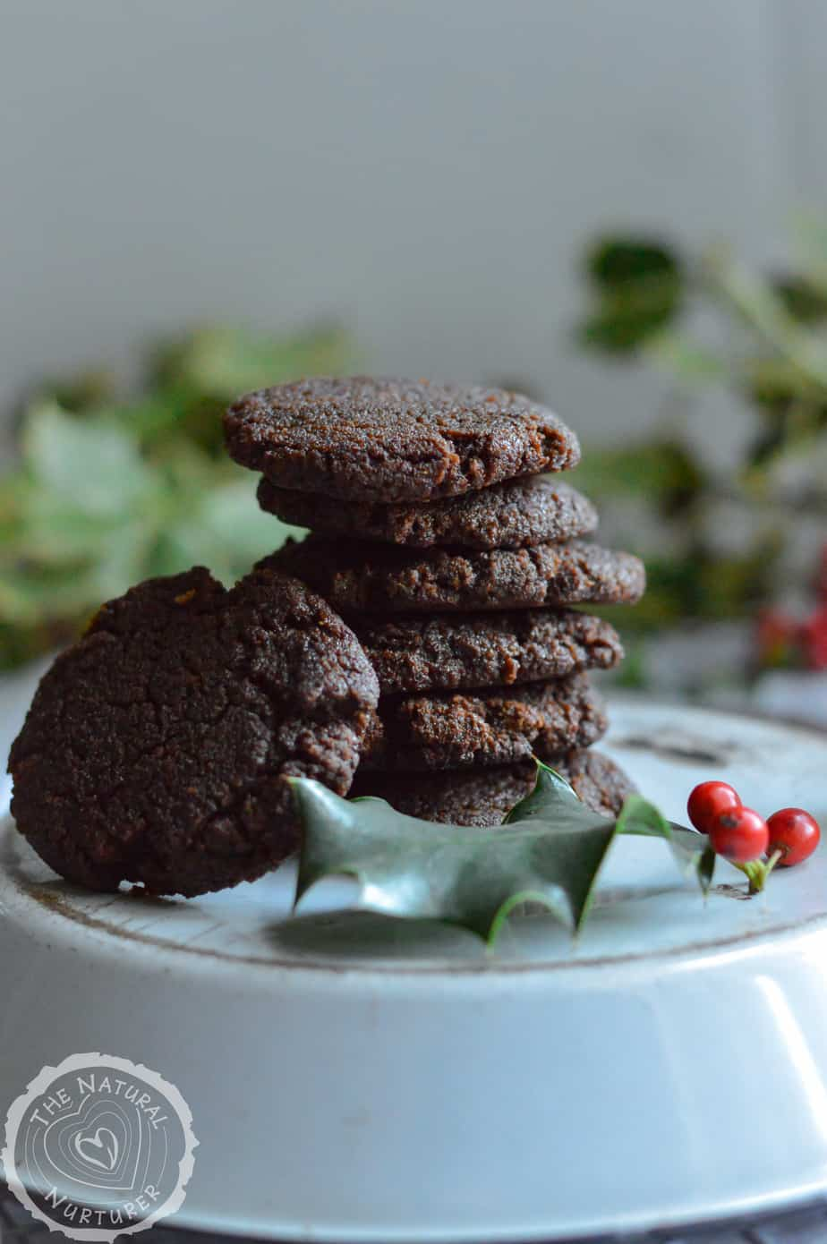 A stack of Grain-Free Gingerbread Cookies on a big plate.