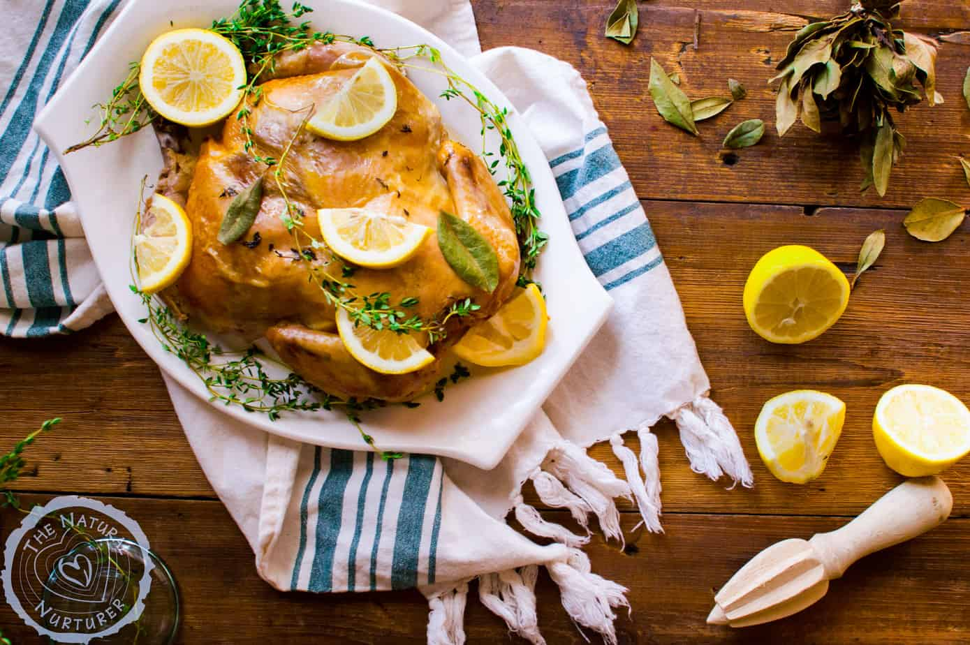 Overhead of the mouthwatering slow cooker lemon thyme whole chicken looking extra inviting and delicious