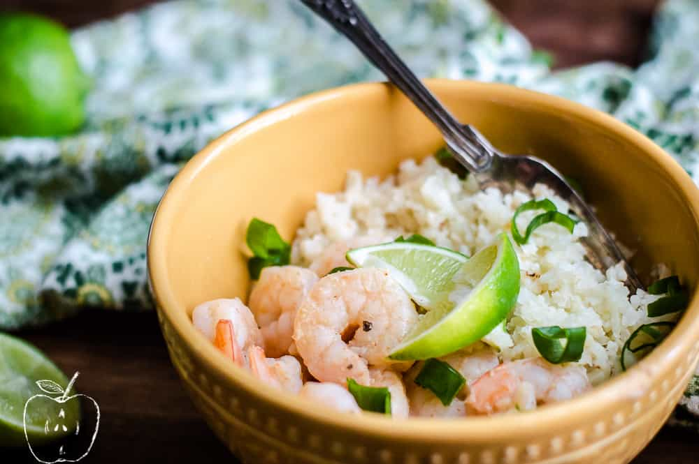 Zesty Lime Shrimp with Simple Cauliflower Rice in a big bowl with a spoon inside the bowl