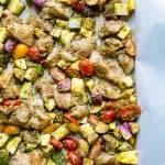Closeup on the delicious One-Sheet Pan Pesto Chicken & Summer Veggies in a pan