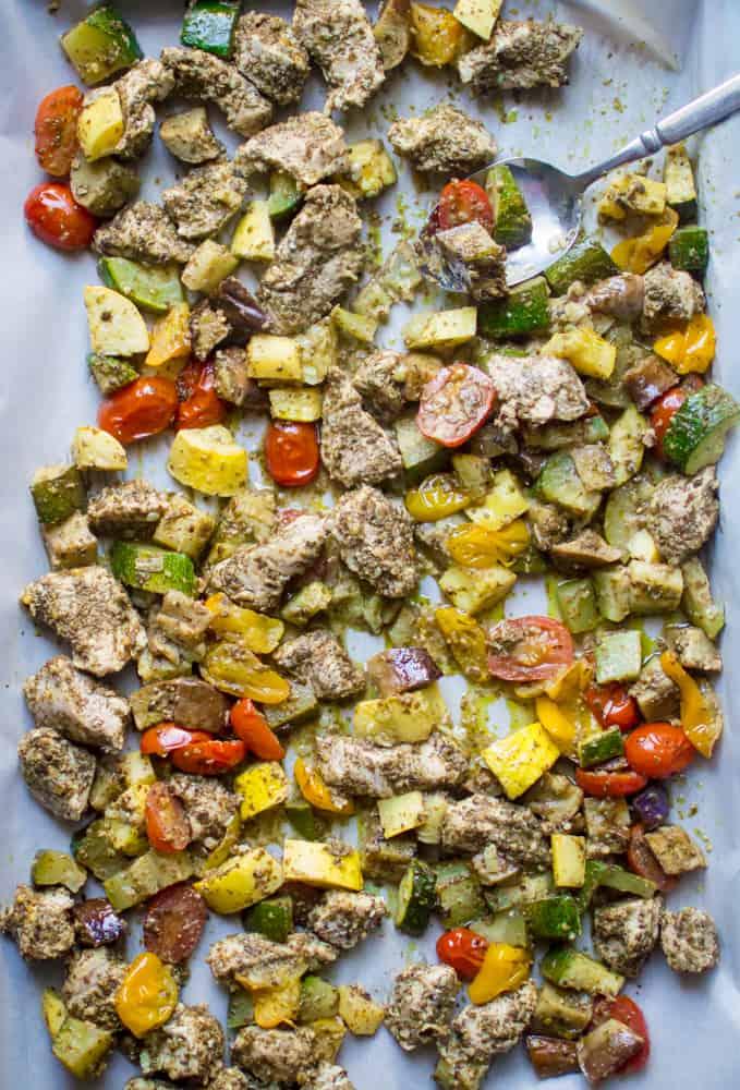 One-Sheet Pan Pesto Chicken & Summer Veggies spread out in a big sheet pan