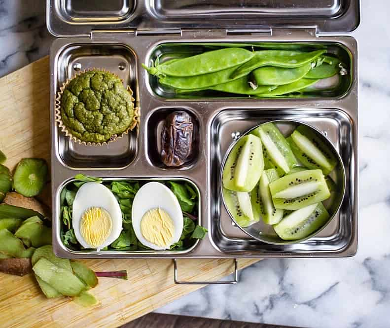 Lunch box contents:  Oatmeal Green Smoothie Muffin , snow peas, sliced kiwi, hard boiled egg, mixed greens, pitted date. Lunch box by  Planet Box .