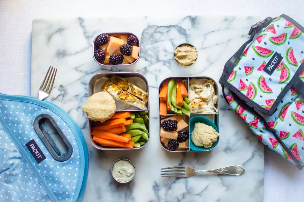 For me: Seasoned chicken breast, grain-free biscuit, carrot sticks & sugar snap peas with hummus for dipping, and cantaloupe with blackberries.  For little one: Same as mama, only with natural peanut butter for dipping veggies in.Hummus isn't my daughter's favorite thing, so I am happy to give her another protein-packed dip