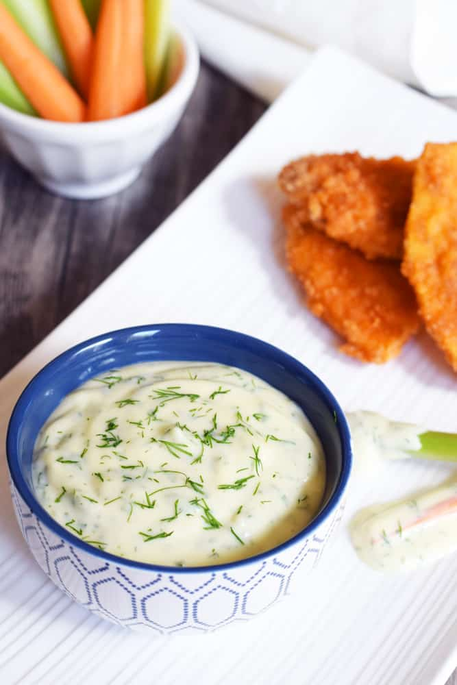 Delicious Paleo Ranch Dressing with veggies on the side that are ready for the dip of the century!
