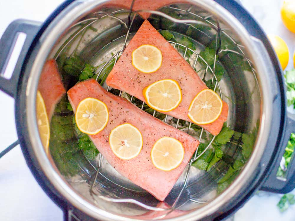Making Instant Pot lemon garlic salmon with frozen salmon and some green herbs
