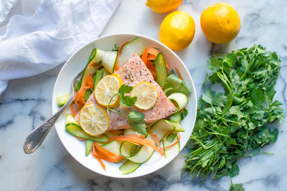 Instant Pot lemon garlic salmon served with vegetables and a metal fork on the side