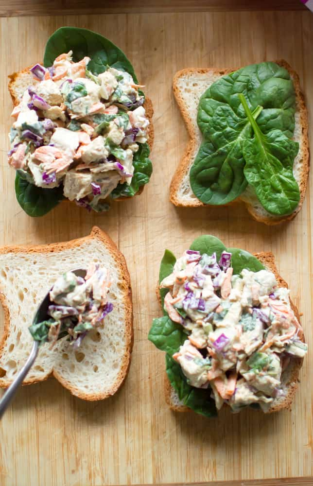 Four big pieces of bread with the most delicious veggie-loaded spring chicken salad on top