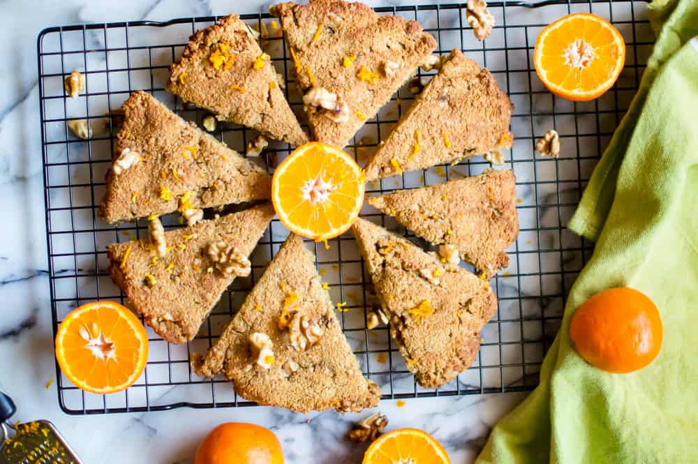 Overhead on the healthy and scrumptious Paleo Orange Walnut Scones straight out of the oven and topped with more walnuts