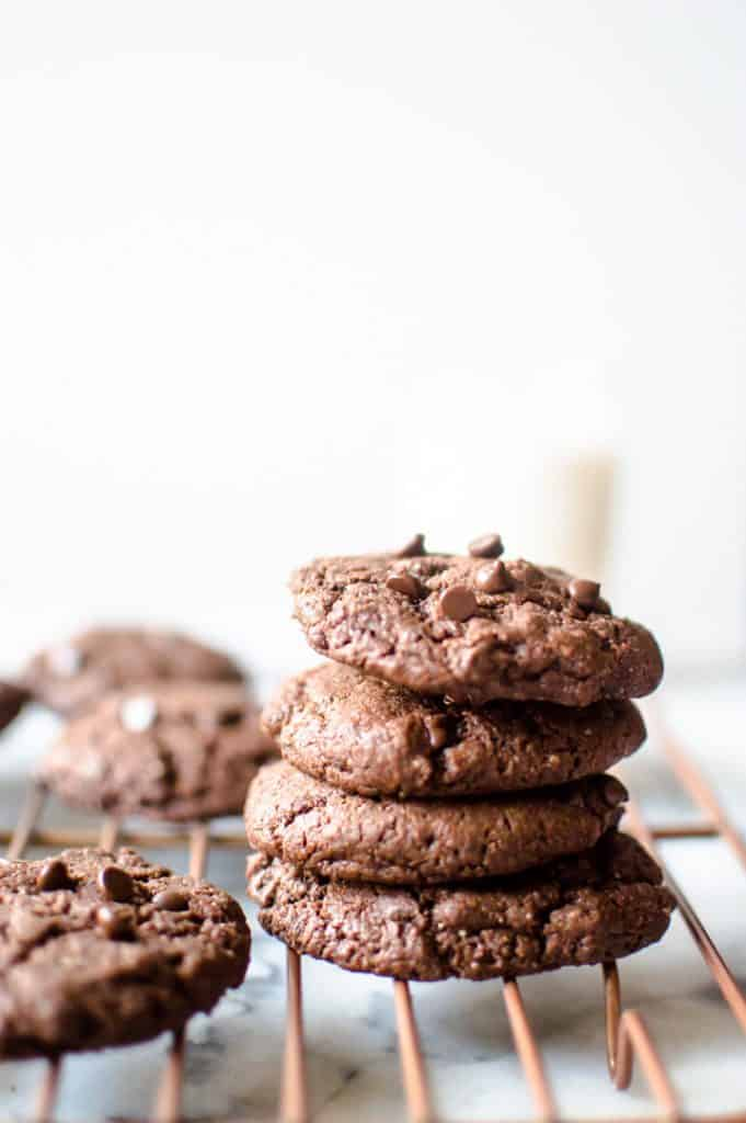 Vegan Chocolate Almond Butter Cookies stacked into a tower looking delicious and absolutely inviting