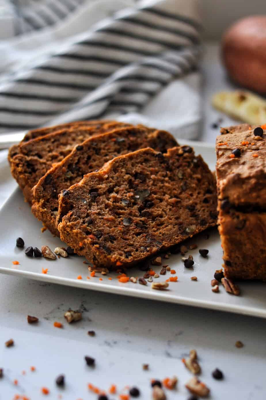 Four pieces of chocolate chip carrot bread showing the perfect texture and chocolate chips inside