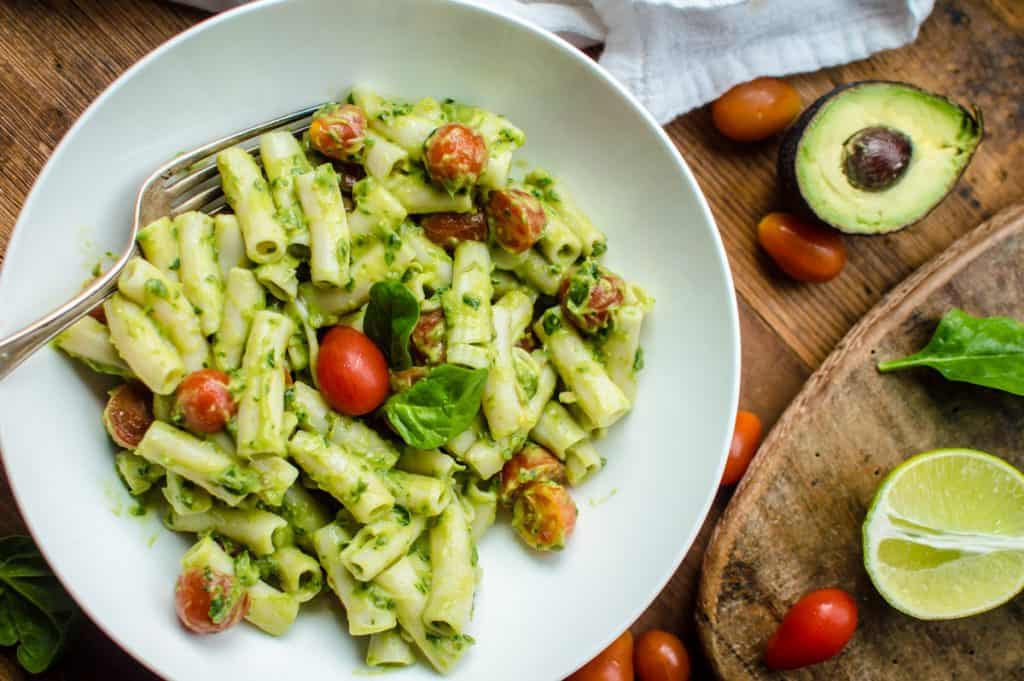 Overhead on a big white bowl full of the delicious Quick & Easy Guacamole Pasta
