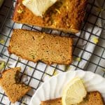 This Paleo lemon zucchini bread is perfectly moist, packed with zucchini and the perfect balance of sweet and tangy! Gluten free, dairy free, nut free option and naturally sweetened- this is one bread everyone will rave about!