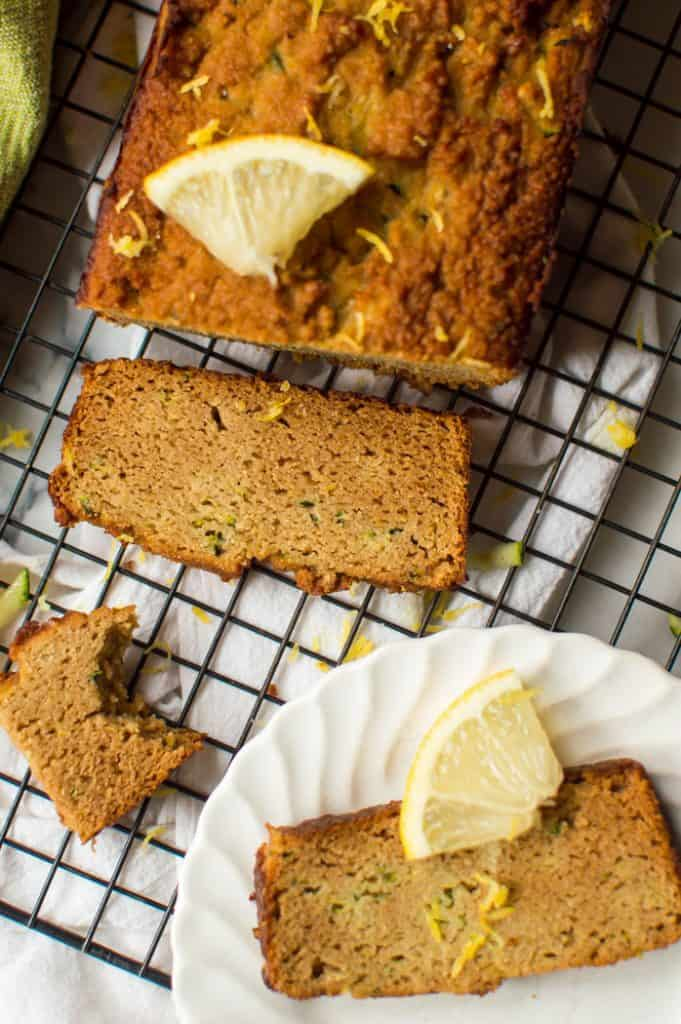 Sliced lemon zucchini bread on cooling rack.