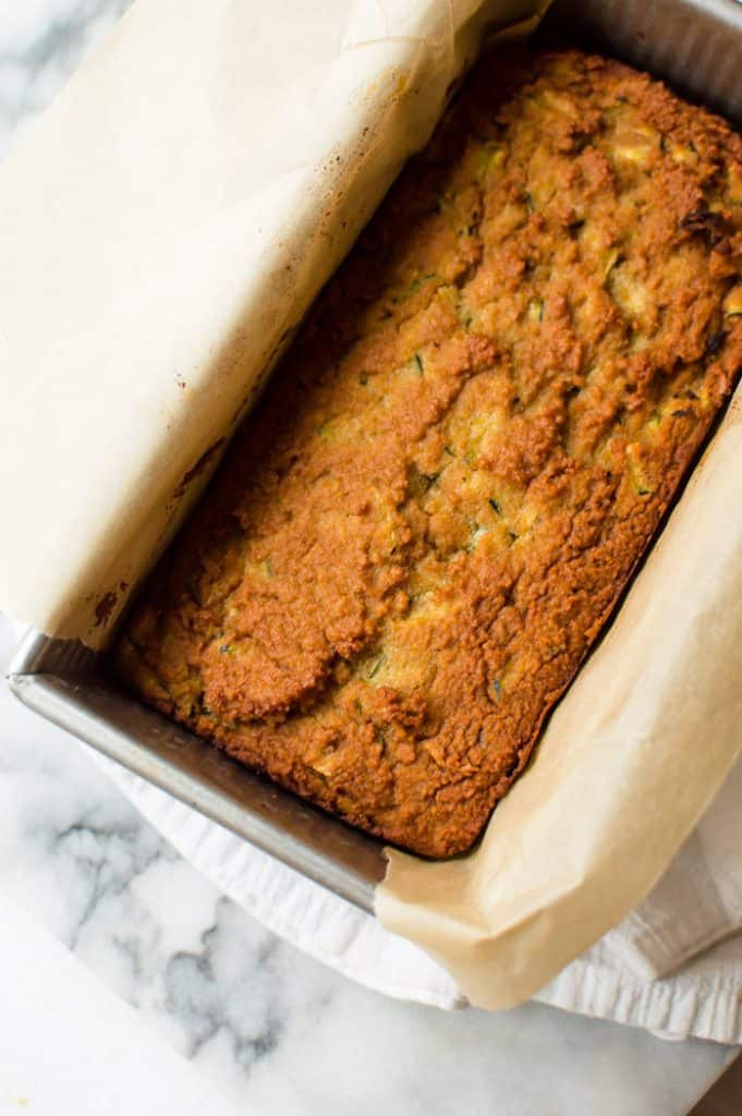 freshly baked loaf of lemon zucchini bread still in pan