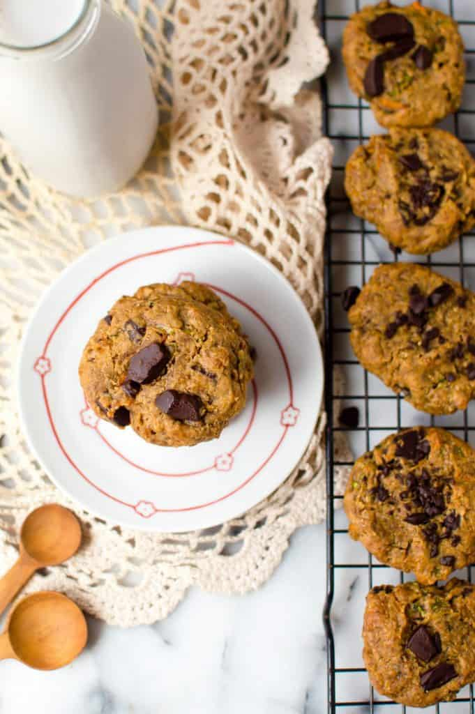 peanut butter carrot zucchini gluten free cookies cooling with one on a plate