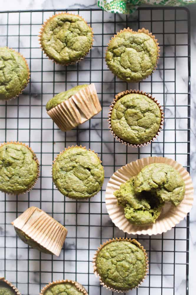 Overhead on oatmeal green smoothie muffins, hot and ready straight out of the oven - one of the 15 healthy muffin recipes for kids