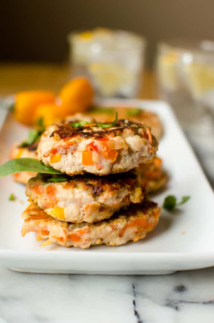 3 Healthy turkey burgers stacked on a plate