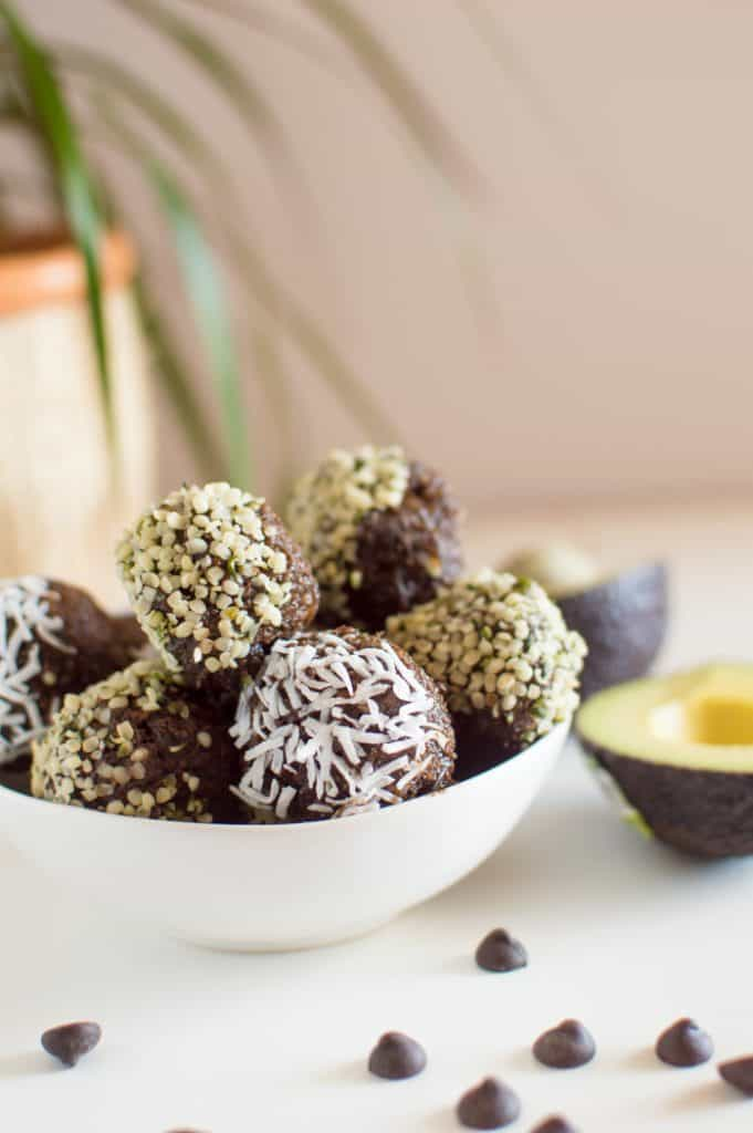 Just 7 wholesome ingredients stand between you and these healthy, no-bake Chocolate Avocado Bites– a vegan, nut-free and Paleo recipe that is perfect treat to whip up when it is too hot to cook.