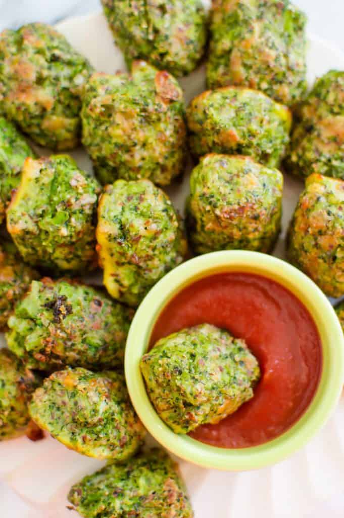 These gluten free Broccoli Tots are easy, delicious, and a veggie-loaded version of the classic tot so many of us grew up on. The combo of broccoli with cheese is the perfect flavor combination. #healthyside #glutenfree #kidfriendlyvegetables