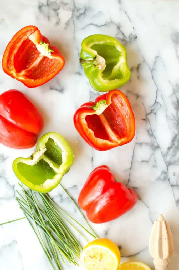 These Lemon Garlic Chicken Stuffed Peppers are easy, loaded with flavor, and are so delicious! A simple healthy no-cook meal for summer and are Paleo, Whole30 and gluten free!