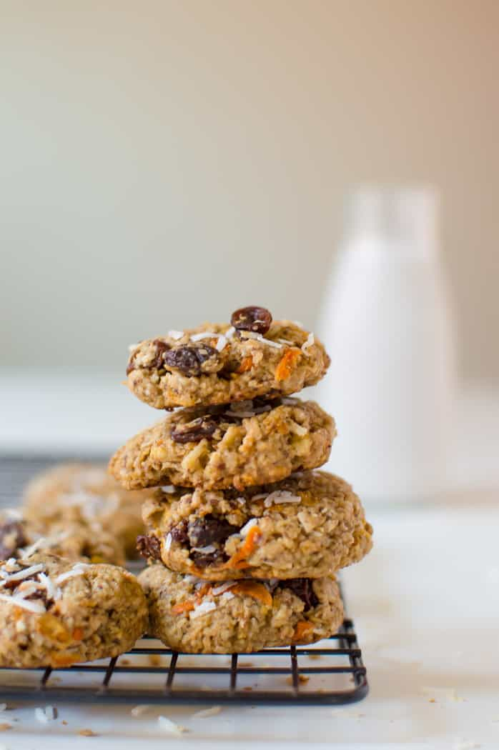 Morning Glory Breakfast Cookies served in a tower of four cookies with a jar of milk blurred in the background