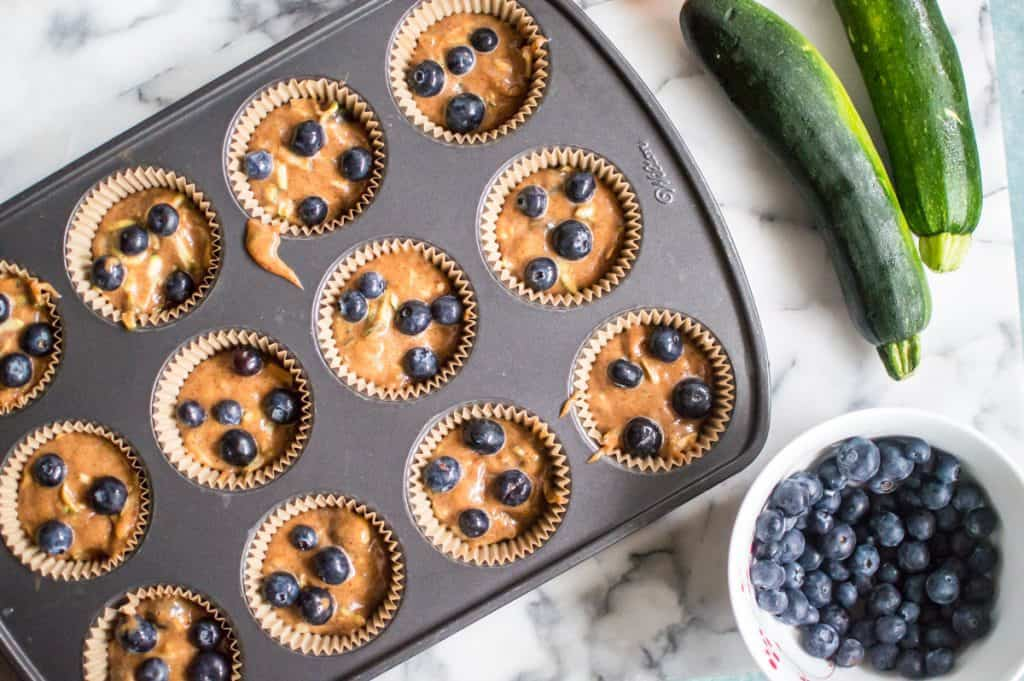 These Almond Butter Blueberry Zucchini Muffins are easy, fluffy, and so delicious! Paleo, gluten free, dairy free, but no one will be able to tell!