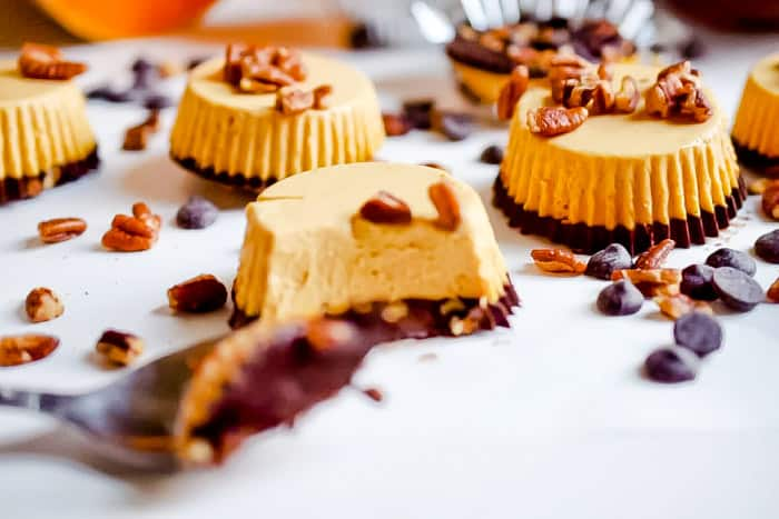 This no-bake mini Paleo Pumpkin Cheesecake recipe makes mini, delicious treats that are made from real food ingredients! Full of healthy fat, protein and pumpkin, these mini cheesecakes are dairy-free and perfect for a fall treat!