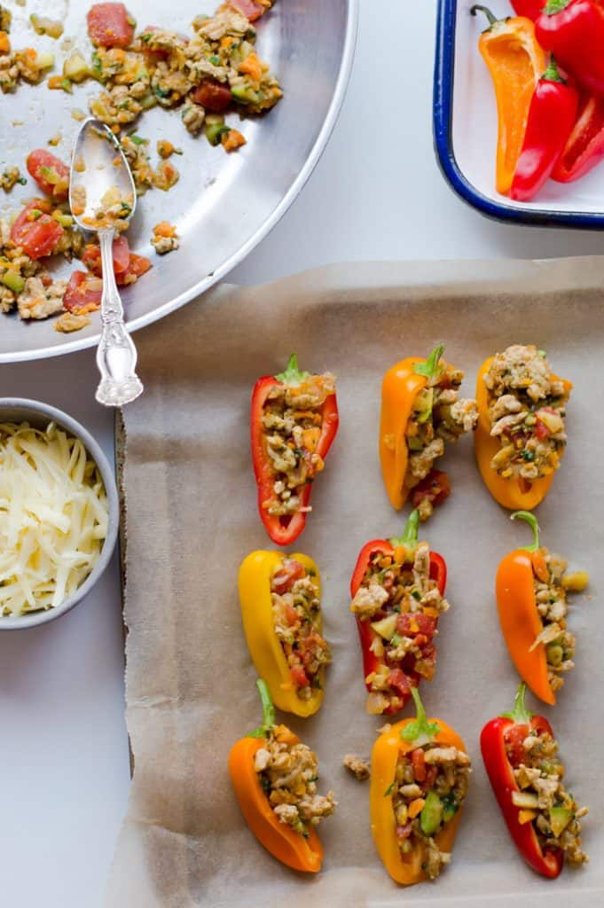 mini bell peppers being stuffed with taco filling