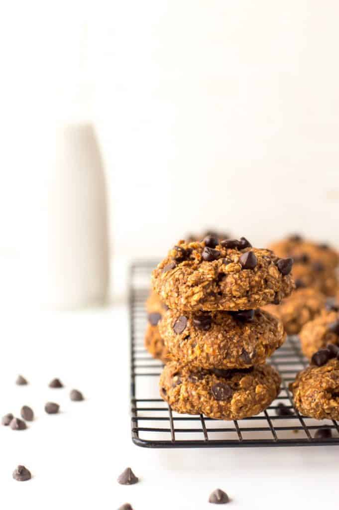 chocolate sweet potato cookies stacked on a cooling rack