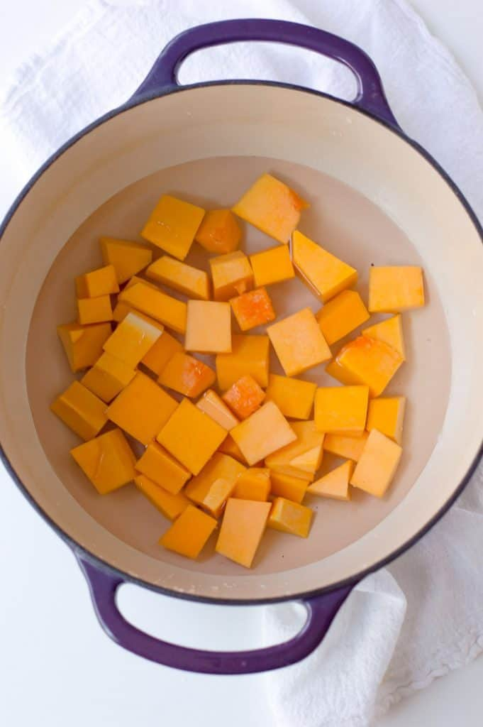 cubed butternut squash in a pot with water