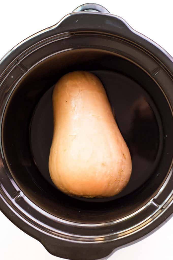 a whole butternut squash in a slow cooker