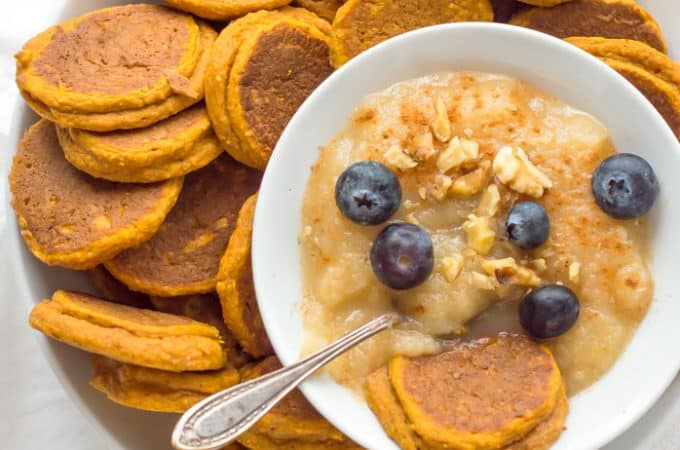 Healthy Sweet Potato Pancakes served with puree, blueberries and a metal spoon on top