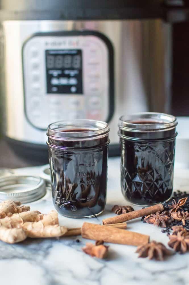 jars of Instant Pot elderberry syrup cooling in jars