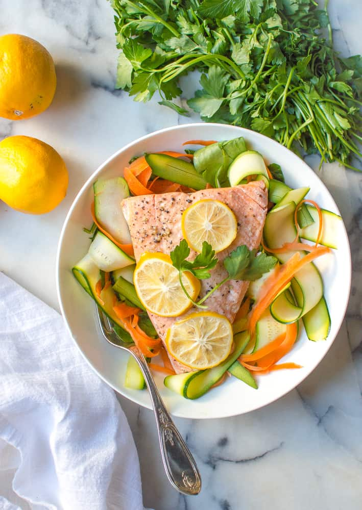 Instant Pot Salmon made with lots of veggies and two lemons on the side