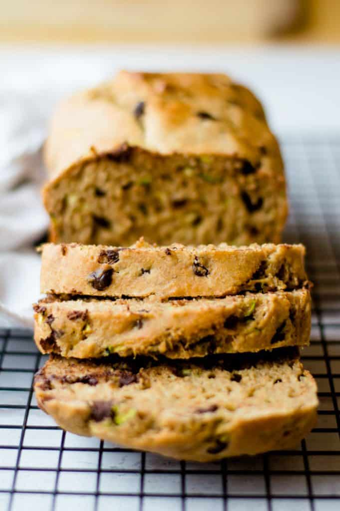 Healthy zucchini bread on cooling rack, sliced