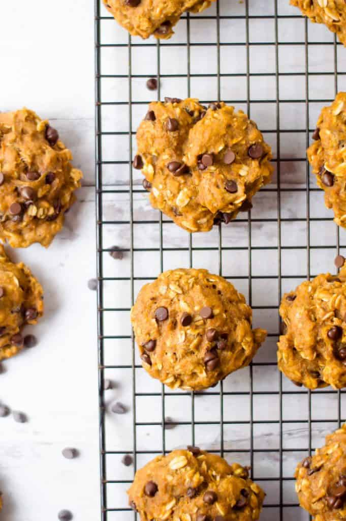 Kid-friendly, healthy oatmeal pumpkin cookies on the white surface looking absolutely inviting and delicious.