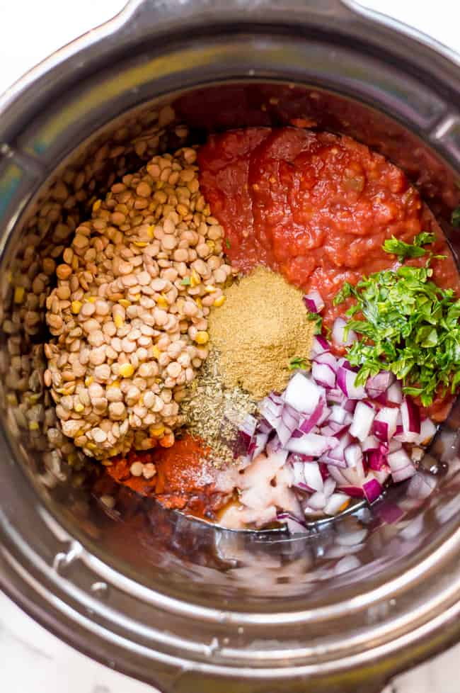 Ingredients for vegan slow cooker lentil tacos in the slow cooker before being mixed or cooked.