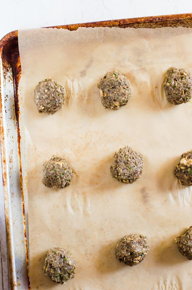 Lentil meatballs on the baking sheet before cooking.