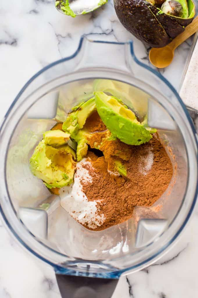The ingredients for chocolate avocado mousse in a blender before pureeing.