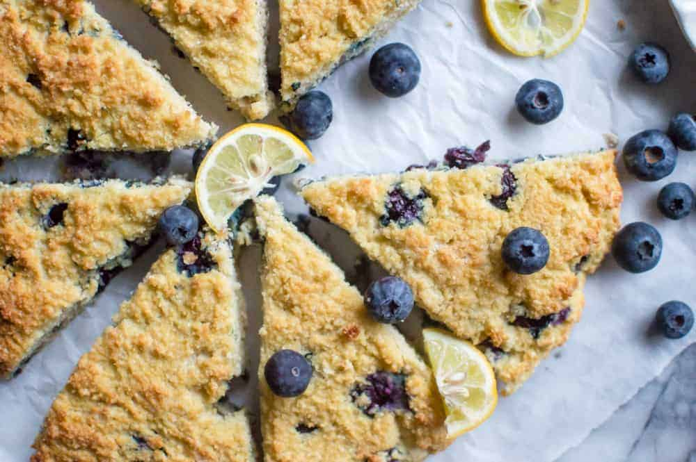The batch of lemon blueberry paleo scones with a scone removed.